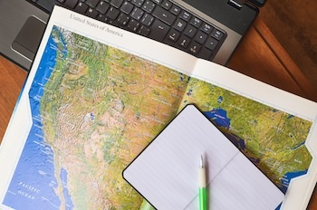 Map-Blank-Notebook-Pen-and-Laptop-1.jpg